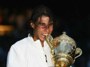 Rafael\'s first ever bite of the Wimbledon Trophy
